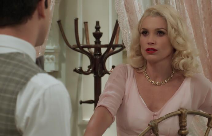 Sandra diz a Celso que precisa da ajuda de Ernesto (Foto: TV Globo)