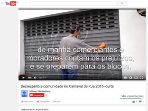 Gravação mostra homem cobrindo pichação feita durante carnaval de rua na Vila Madalena (Foto: Reprodução / YouTube)