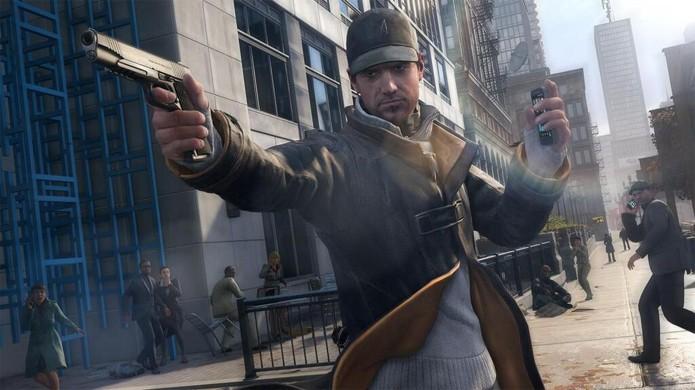 Aiden Pearce exibe sua arma mais poderosa em mãos... seu smartphone (Foto: Divulgação)
