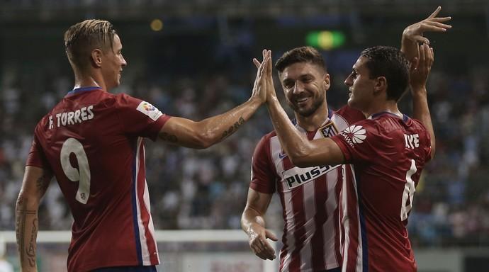 Guilherme Siqueira Koke e  Fernando Torres Atlético de Madrid (Foto: Chris McGrath/Getty Images)