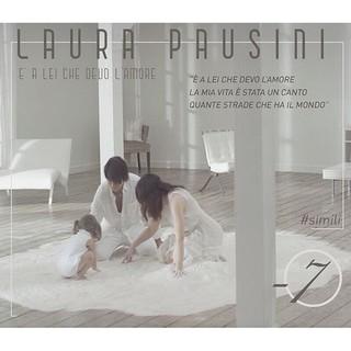 Capa do single 'E' a lei che devo l'amore', em que Laura aprece com o marido e a filha (Foto: Reprodução/Instagram)