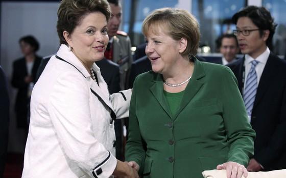 A presidente do Brasil, Dilma Rousseff, e a chanceler da Alemanha, Angela Merkel, em foto de 2011 (Foto: Chris Ratcliffe-Pool/Getty Images)