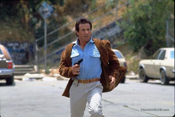 Sylvester Stallone em 'Pare, Senão Mamãe Atira!' (1992)  (Foto: Divulgação)
