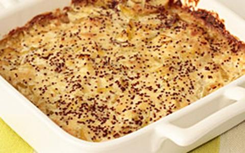 Batata gratinada com creme de queijo e alho-poró