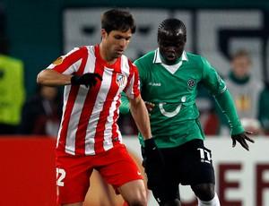 Diego e Didier Ya Konan (Foto: AP)