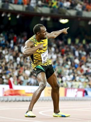 Usain Bolt antes de ser atropelado por câmera chinês em segway após final dos 200m do Mundial de Atletismo (Foto: Reuters)