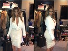 Kim Kardashian posa de visual decotado e comemora