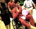 Após cirurgia em Londres, Liu Xiang volta para China em cadeira de rodas
