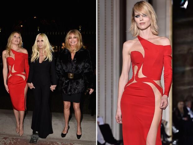 Kate Hudson se prepara para ocupar a primeira fila da Versace com vestido da marca que revela a ausncia de lingerie. Top Eva Herzigova desfilou o mesmo modelo na passarela (Foto: Getty Images)
