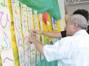 Exposição de pinturas japonesas durante comemoração (Foto: Graziela Miranda/G1)