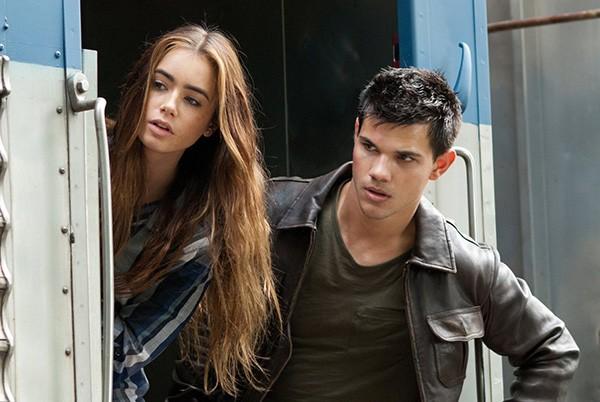 Taylor Lautner e Lily Collins em 'Sem Saída' (2011) (Foto: Divulgação)