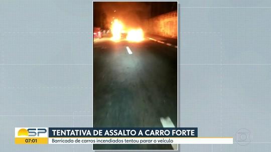 Barricada de carros incendiados tentou parar carro-forte, diz polícia