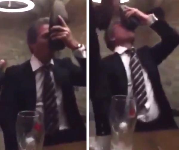 O ator Hugh Grant bebendo com seu próprio sapato (Foto: Facebook)