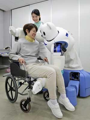 A máquina de olhos grandes tem características de um urso polar, mas é delicada com seus pacientes. (Foto: Jiji Press / AFP Photo)