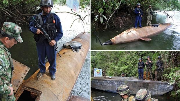 Soldados colombianos guardam um submarino construído para levar carregamentos de droga em uma área florestal perto do porto de Buenaventura. Apreendido na véspera, o equipamento tem capacidade para levar até 5 toneladas de droga, segundo as autoridades. (Foto: Felipe Caicedo/AFP)