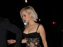 Jennifer Lawrence surge com vestido supersexy em boate de Londres