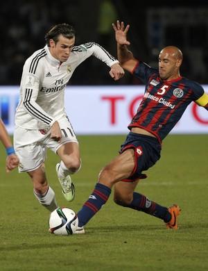 Bale, Juan Mercier e Pablo Barrientos, São Lorenzo x Real Madrid (Foto: AP)