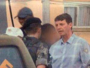 Pithan flagrado no local onde suspeito foi agredido por vigilante em Pelotas, RS (Foto: Reprodução/RBS TV)