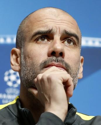 Guardiola na entrevista coletiva do Manchester City para a Liga dos Campeões (Foto: Martin Rickett/PA via AP)