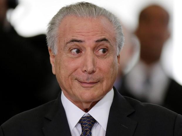 O presidente em exercício Michel Temer participa de cerimônia com uma delegação de atletas olímpicos no Palácio do Planalto, em Brasília (Foto: Ueslei Marcelino/Reuters)