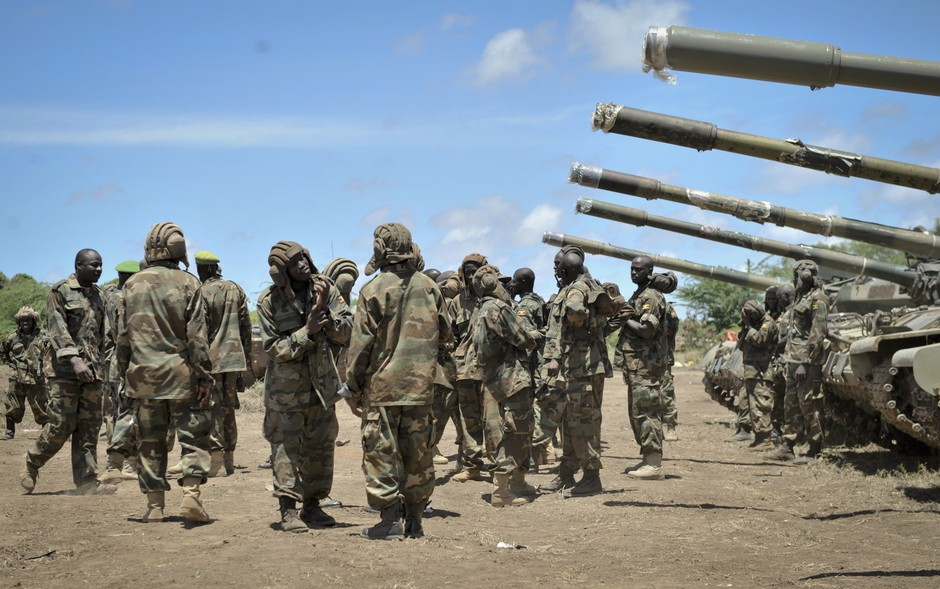 In this photo taken Friday, Aug. 29, 2014 and provided by the African Union Mission to Somalia (AMISOM) on Saturday, Aug. 30, 2014, African Union (AU) soldiers from Uganda gather around their tanks as they prepare to launch an offensive against al-Shabab