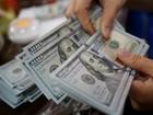 Dólar termina semana em queda, com cenário externo e sem ação do BC