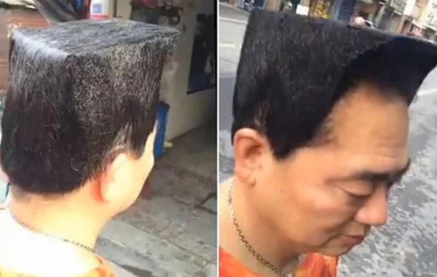 Taiwanês de 53 anos fez um penteado bizarro com objetivo de parecer mais jovem (Foto: Reprodução/YouTube/Amez News)