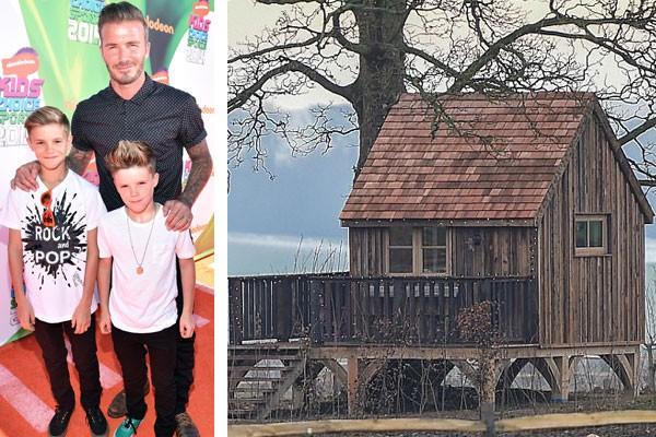 David Beckham ao lado dos filhos Romeo e David Beckham, e a modesta casa na árvore das crianças (Foto: Getty Images)