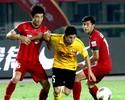 Guangzhou vence com assistência do 'moreno' Conca e 1º gol de paraguaio