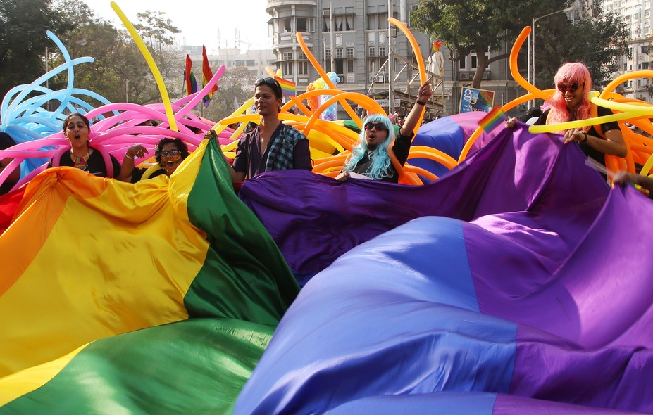 Supporter of the lesbian, gay, bisexual and transgender community wave a rainbow flag during a gay pride parade in Mumbai, India, Saturday, Jan. 31, 2015. Gay rights supporters waved flags and danced during the march to celebrate gay pride and to push for