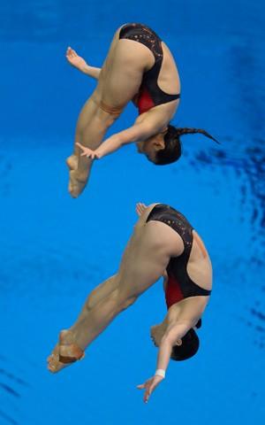 Zi He e Minxia Wu saltos ornamentais londres 2012 olimpiadas (Foto: AFP)