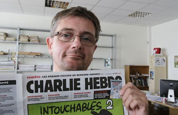 Diretor da revista satírica 'Charlie Hebdo' foi ameaçado por publicar charges de Maomé. (Foto: Michel Euler/AP)