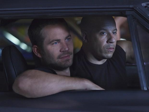 Paul Walker e Vin Diesel em 'Velozes e furiosos 5: Operação Rio' (2011). (Foto: Divulgação)