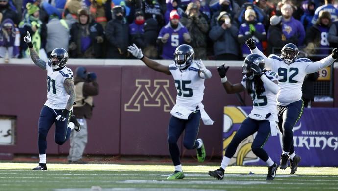 Jogadores Seattle Seahawks comemoram vitória playoffs nfl (Foto: Reuters)