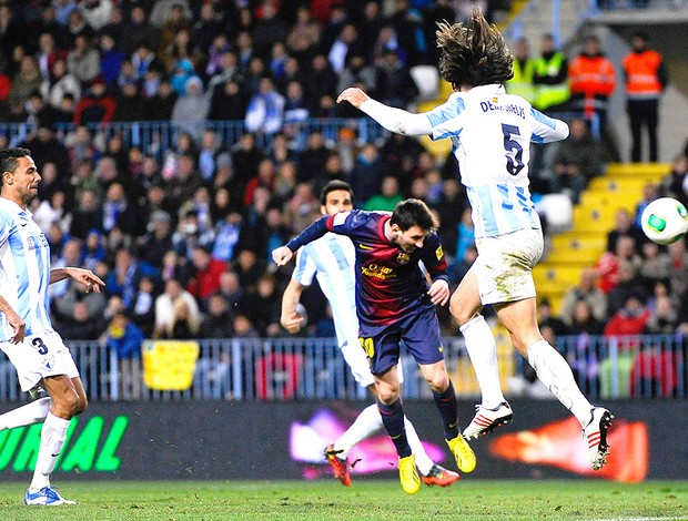 Messi marca gol do Barcelona contra o Málaga (Foto: Getty Images)