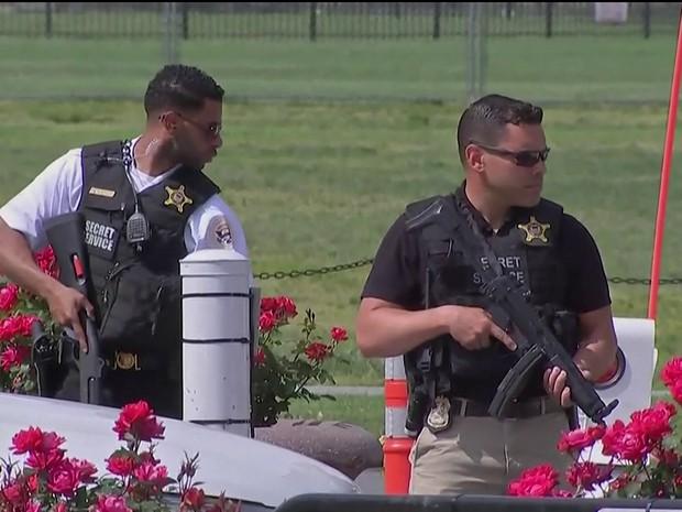 Agentes armados (Foto: Reprodução/Globonews)