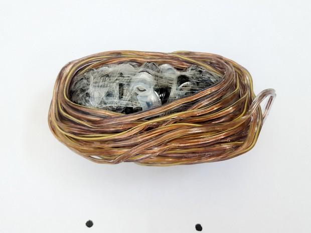 Mulher escondeu 9,6 metros de fio de cobre flexível, além de fones de ouvido, dentro das partes íntimas (Foto: SAP/Divulgação)