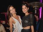 Adriana Lima e Raica Oliveira ousam com modelitos com transparência