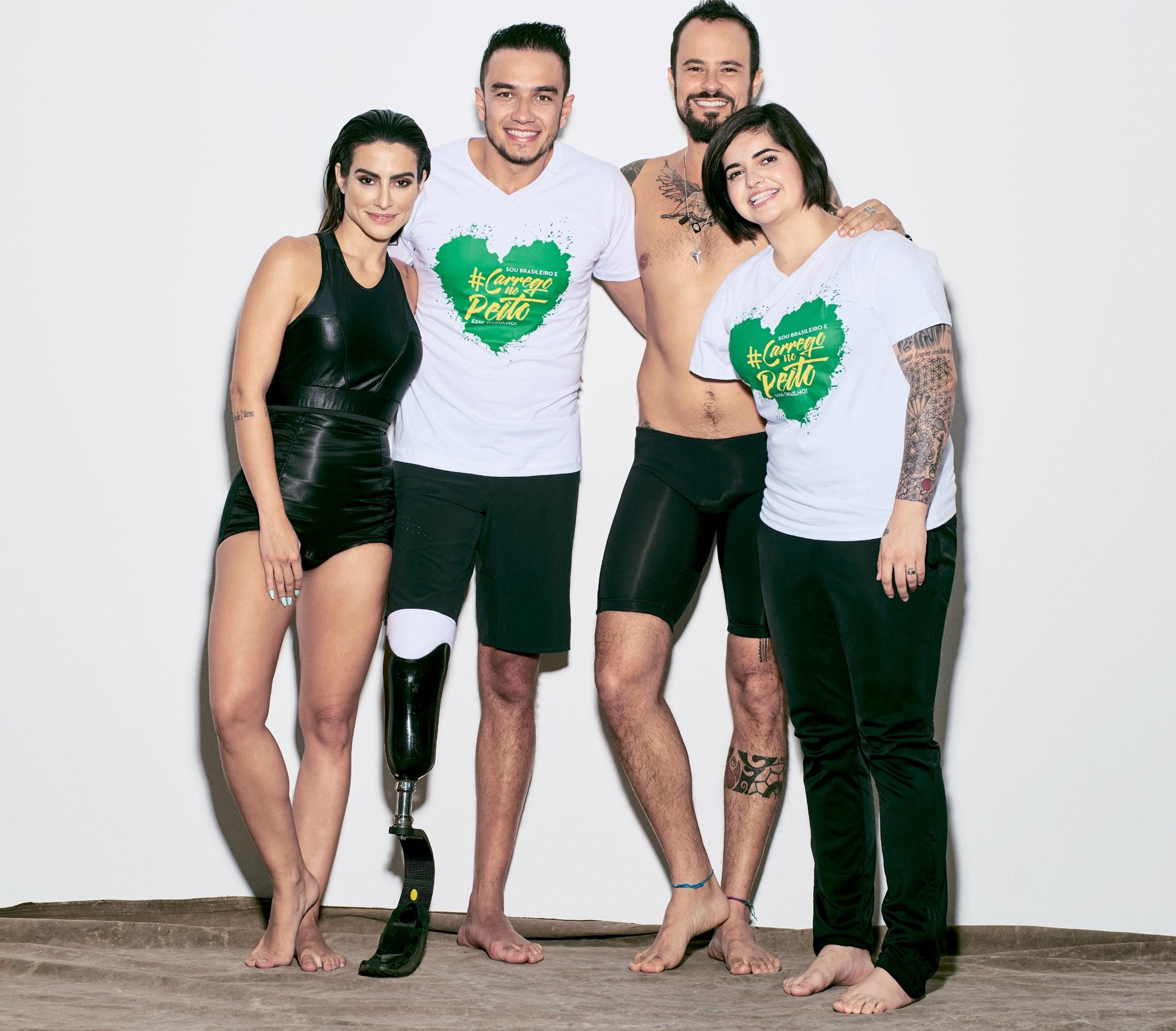 Cleo Pires e Paulo Vilhena com os paratletas nos bastidores da campanha (Foto: Reprodução)