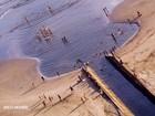 Mar avança e cria 'violão' em praia; Foto viralizou 12 anos após ser tirada