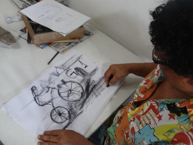 O artista fez um desenho especial para a reportagem do G1. (Foto: Derek Gustavo/G1)