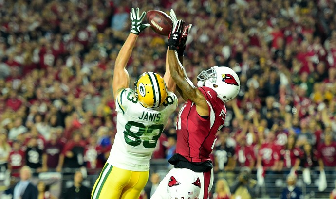 Janis recebe passe de Aaron Rodgers, pelo Green Bay Packers, contra o Arizona Cardinals (Foto: Harry How/Getty Images)