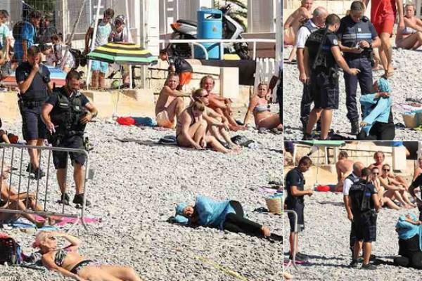 Cena em que policiais aparecem abordando mulher em praia francesa (Foto: Reprodução/Twitter)