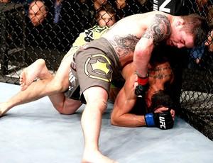 Andy Ogle na luta do UC contra Josh Grispi (Foto: Getty Images)