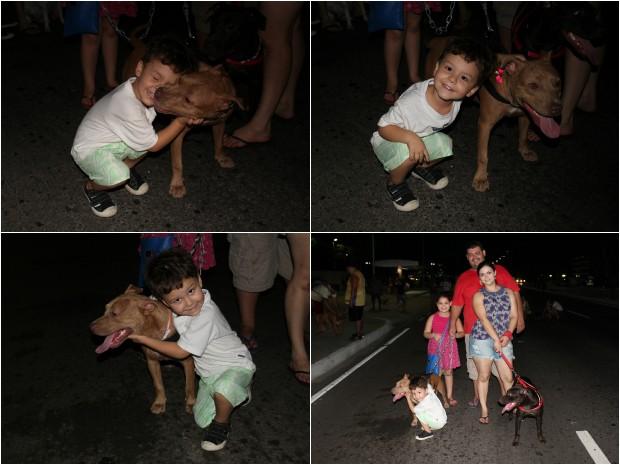Lucas agrada pit bull de estimação da família (Foto: Jamile Alves/G1 AM)