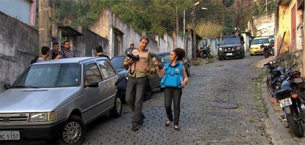 Profissão Repórter mostra o dia a dia de um fotógrafo em cobertura policial (Foto: Divulgação Rede Globo)