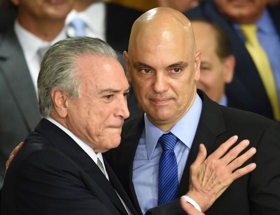 Presidente interino Michel Temer e o novo ministro da justiça Alexandre de Moraes (Foto: Marcos Correa/AFP)