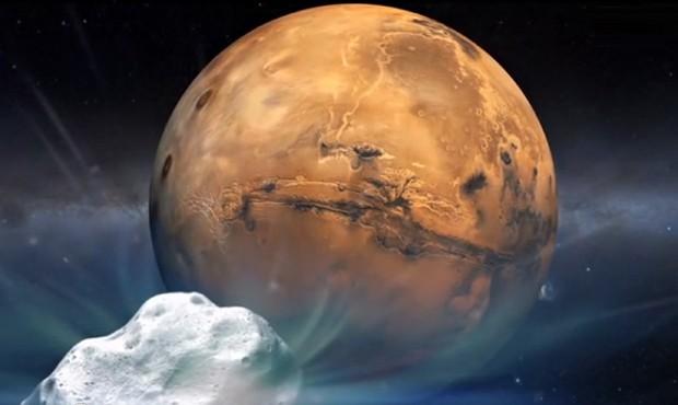 Ilustração mostra cometa 'Siding Spring' passando por Marte (Foto: AFP Photo/Nasa)