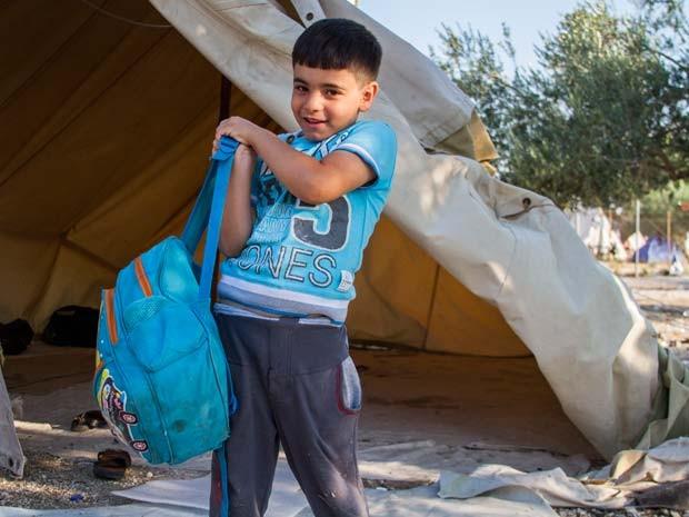 Omran tem 6 anos e viaja à Alemanha junto com 5 familiares (Foto: Tyler Jump/International Rescue Committee)
