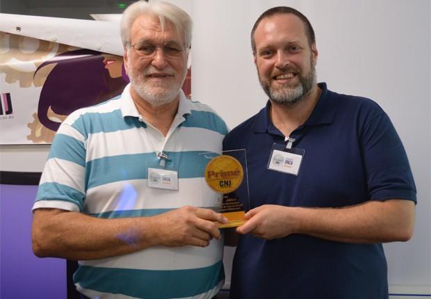 José Onça e Fabiano Onça: pai e filho foram os vencedores do concurso de jogos de tabuleiro mais prestigiado do mundo (Foto: Arquivo pessoal)